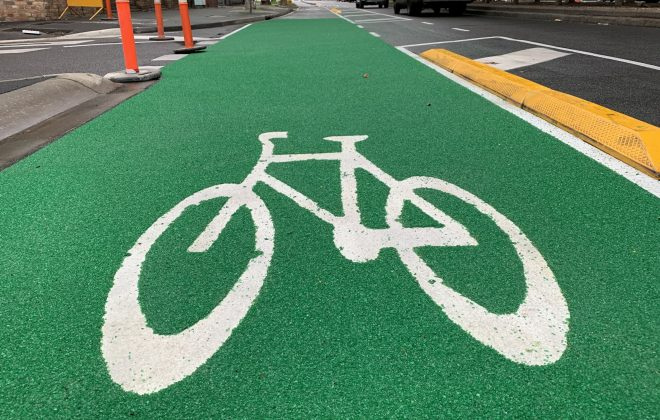 Bicycle logo on green recycled-glass OmniGrip CST bicycle lane in Southbank Melbourne