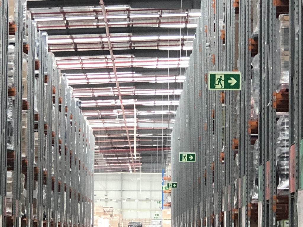 Photoluminescent exit signs in Bunnings Distribution Centre