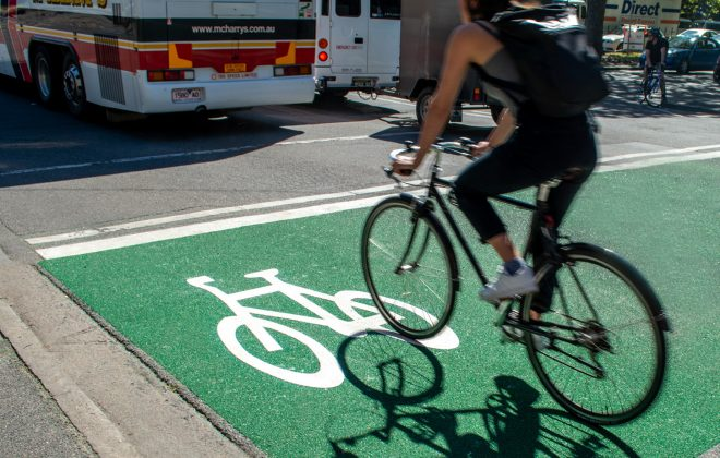 Rider on new OmniGrip CST bicycle lane Linlithgow Avenue in Melbourne. Higher skid resistance surfaces like this make bicycle lanes safer.